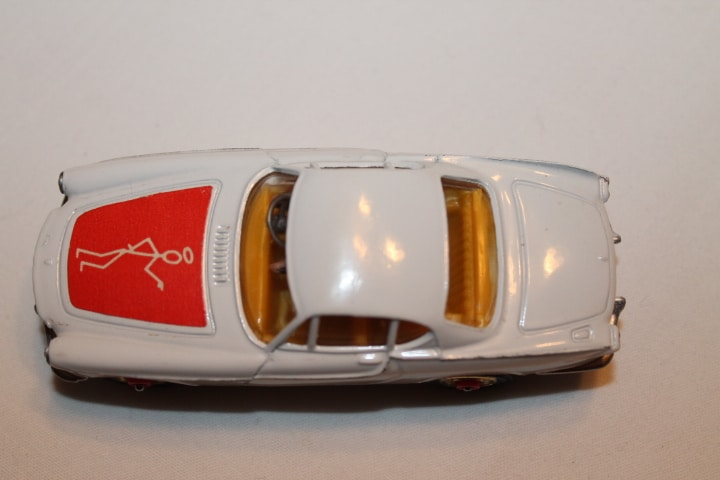 Corgi Toys 201 Volvo P.1800 The 'Saint's Car-Red Spot wheels-top